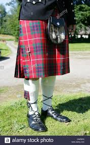 man wearing traditional scottish kilt and sporran texting on