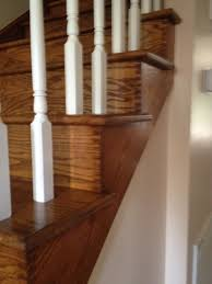 red oak stair treads and white risers with white spindles located