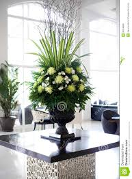 beautiful flower arrangement in large foyer royalty free stock