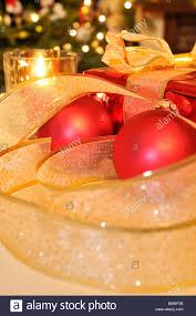 gold christmas ribbon baubles ornaments red wrapped present and