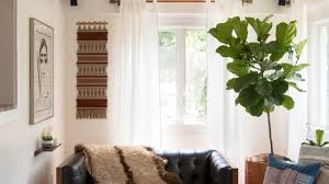 how to make a small room feel bigger weekend design use full scale decor to make a small room feel