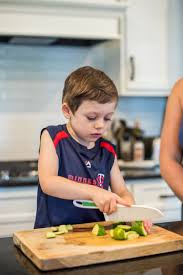 4 year old caden whitmore leans on his kid approved knives knives