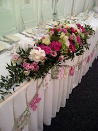 white vase coral flowers wedding reception wedding flower table