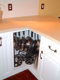 how to organize pots and pans in cabinet a 14 towel bar is a genius way to organize pots and pans