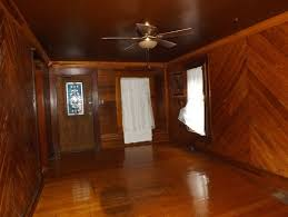 painted wood walls lighten look of wood room in 1920s cottage without painting wood