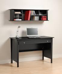 black wooden desk with drawer on beige wooden laminate floor