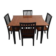 dining tables bobs furniture diva dining room boomerang table