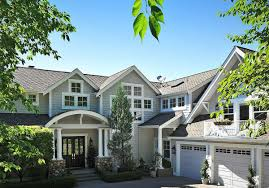 luxury shingle style house plan with multiple gathering spaces