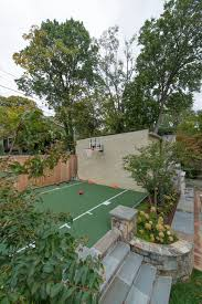 backyard batting cages landscape traditional with brick wall