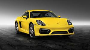 porsche cayman s sport hd wallpapers porsche exclusive shows off cayman s with racing yellow finish