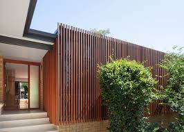 mid century bungalow in sydney is wrapped in a stunning slatted