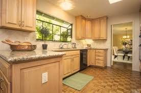 maple cabinets with granite countertops what wood flooring would work with my maple cabinets and granite