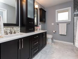 dark cabinets white counter tops and a marble floor add an air of