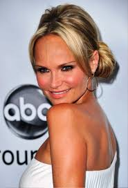 pictures of kristin chenoweth casual low bun updo hairstyle