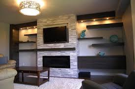 chic interior room design with stone veneer fireplace plus shelf