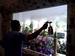 spraying screen goo on a glass window in a dining hall youtube