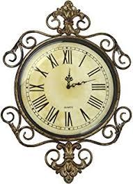 Decorative Metal Wall Clocks Amazon Com Uttermost Delevan Wall Clock Home U0026 Kitchen