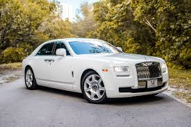 roll royce wood rolls royce ghost series ii white miami exotics exotic car rentals