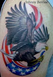 new eagle with american flag tattoo on arm photos pictures and