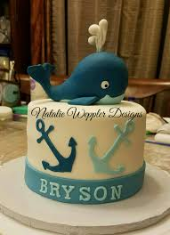 this baby shower cake features a nautical theme with a baby whale