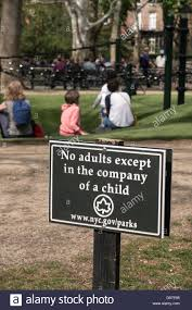 no adults except in the company of a child sign playground stock