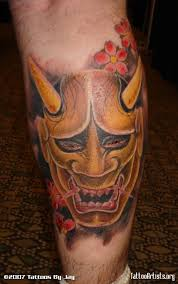 stunning oni mask tattoo design on calf tattooshunter com