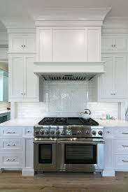 kitchen hood vent in traditional with dark wood floor contemporary