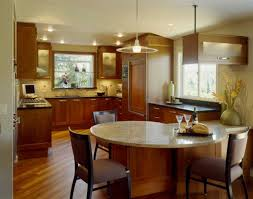 traditional style kitchen peninsula design with dining table