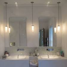 should vanity lights hang over mirror pendant lighting for bathroom vanity a different take on typical