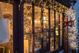 festive lights outside a shop window stock photo image 47252548