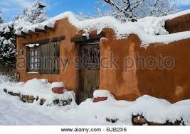 adobe style home adobe style home in winter in santa fe new mexico stock photo