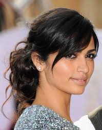 black hairstyles bun with bangs camila alves disheveled curly bun with low side bangs prom