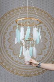 mint and white feather mobile chandelier bohemian nursery