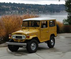 yellow toyota fj40 hard top toyota land cruiser and 4x4