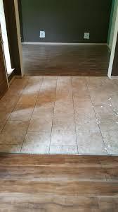 laminate flooring travertine look tile laid on brick pattern