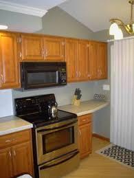 Cinnamon Cabinets With Dark Countertops  Cabinets - Backsplash for black granite