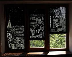 buildings and stars cut into blackout curtains turn your windows