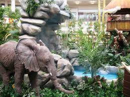 flower rock garden flowers elephant statue snake pond waterfall