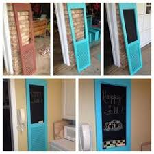 vintage window shutters repurpose tip junkie old shutters painted black or dark taupe this might be neat to