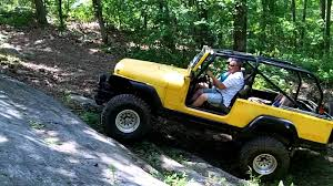 cj jeep yellow yellow jeep scrambler on a rock face youtube