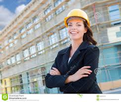 contractor portrait of female contractor wearing hard hat at construction s