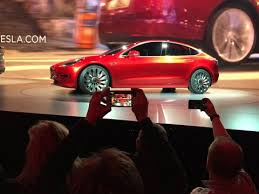elon musk says tesla will deliver first model 3 cars july 28