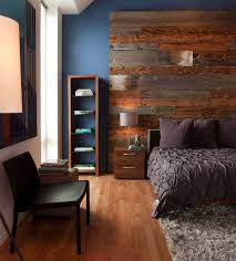 contemporary bedroom blue wall paint rustic wood headboard brown