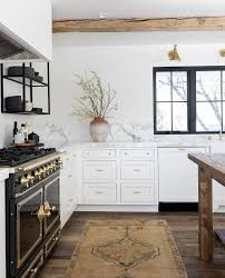 white kitchen cabinets with wood beams how to design a luxurious white and gold kitchen
