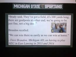 photo rivalry bulletin board material up in michigan state building