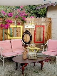 old windows and frames spray painted on fence backyard