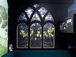 harry potter decor the great hall with floating candles seen through a window from