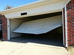 Used Overhead Doors Signs Of A Faulty Overhead Door Repair Teds Garage News