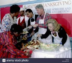 president bill clinton and clinton feeding the
