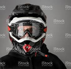 motocross helmets with goggles scared motocross motorbike rider with enduro helmet stock photo